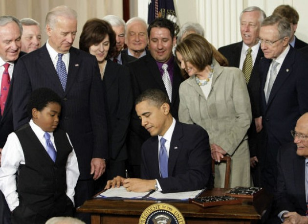 Obama Signs The Affordable Care Act